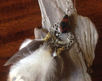 Handmade solitaire feather and obsidian earring.