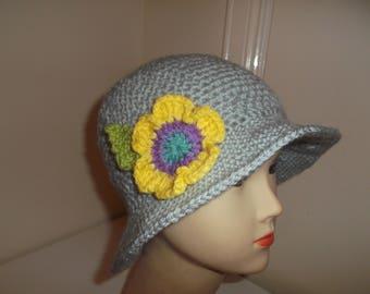 silver  grey brimmed hat  flower on the  side