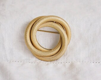 Trio of Rings Gold Tone Brooch