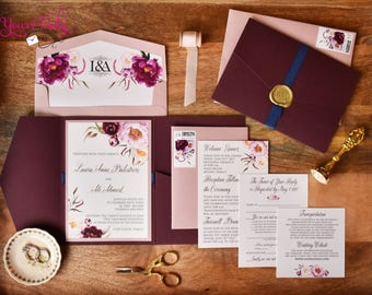 Sample  Romantic Deep Red, burgundy, blush and greenery pocket wedding invitation shown with custom wax seal, stamps and gold foil printing