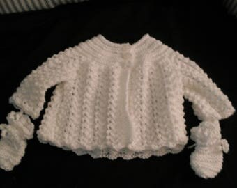 Hand knit baby girl's white lacy sweater set with bonnet, mittens, and booties