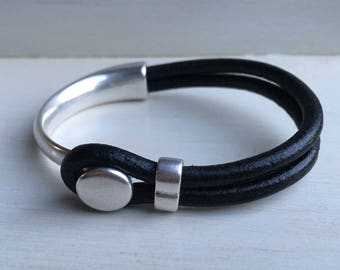BLACK leather with SILVER half cuff button clasp.