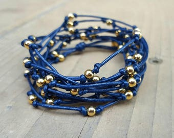 Multi Strand Navy Leather and Gold Bead Bracelet