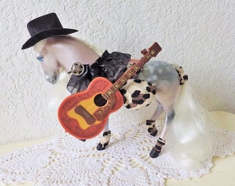 Fashion Star Fillies, Chloe, wearing a hand crafted fashion with guitar and cowgirl hat. Kenner 1980s toy
