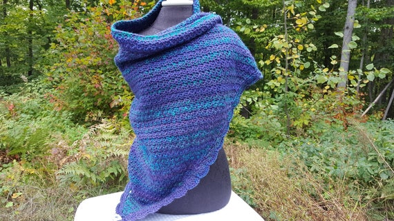 Hand crocheted dragonfly shawl in purples, blues and greens with scallop edging
