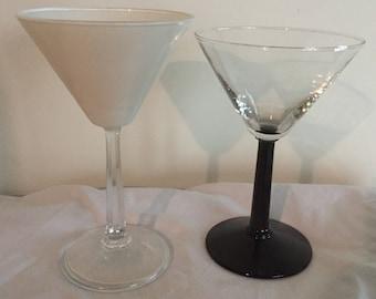 A pair of retro black and white martini glasses.