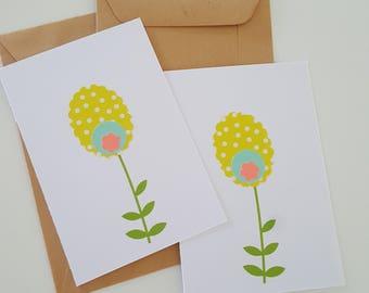 2  bloemen kaartjes geel