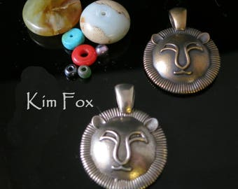 Round Leo Pendant In Sterling Silver and Golden Bronze Designed by Kim Fox - July 23 August 23