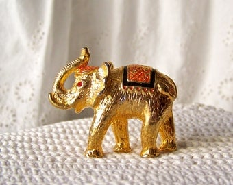Vintage Elephant Miniature Shiny Gold Elephant Trunk Up Elephant Red Rhinestone Eyes 1970s