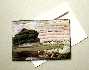 Landscape art in calm tones of pink and green fabric postcard