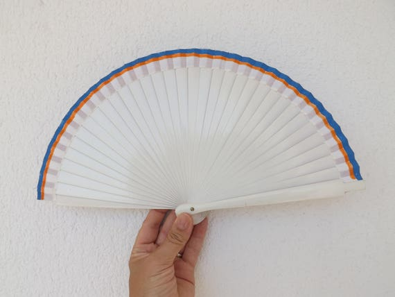 White Blue and Orange Hand Fan
