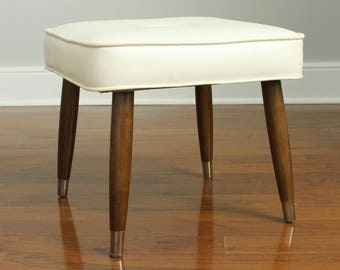 Mid Century Ottoman with Tufted Faux Leather Cushion and Tapered Wood Legs