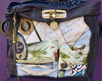 imported one of a kind blue French Christian La Croix leather hand held purse with hand done embellishments
