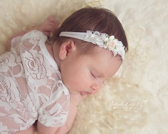 White stretch knit headband with lace, ribbon and a mulberry paper rose by Lil Miss Sweet Pea