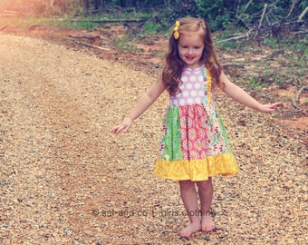 """Girls  """"perfect mismatch""""  dress .     Available girls 6 months to 12 years."""