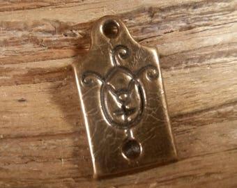 warding glyph protection symbol cast bronze