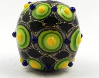 Artisan lampwork glass bead in green, yellow and blue