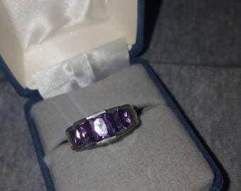 Vintage sterling silver purple stones rings.