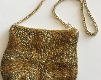 Gold beaded evening bag by Regale.