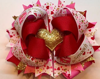 Gold heart Valentines bow. 5 inches wide