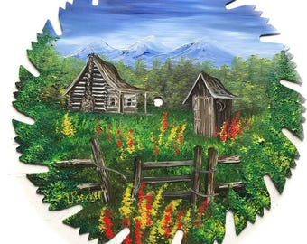 Hand Painted Saw Blade Mountain Summer Cabin and Outhouse