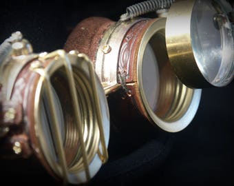 "Steampunk goggles in brown leather and brass with ""protection bars"", moveable loupe and embossed decoration"