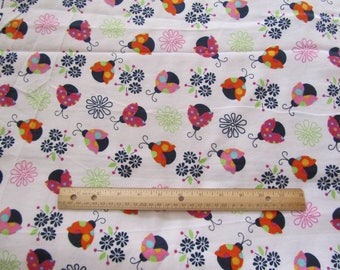 White with Multicolored Lady Bugs Flannel Fabric by the Yard