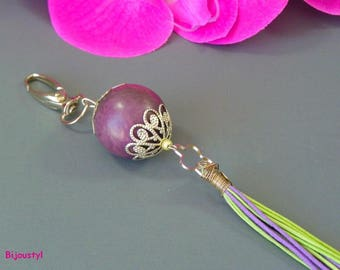 Original this purple Tagua bag charm and purple and green tassel