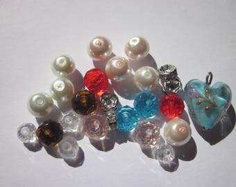 23 round beads and 6-14 mm (BB19) rhinestone rondelles and glass heart