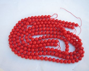 20 round coral beads painted with a red glaze with 4 mm (4)