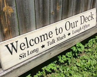 """Handmade, Wooden, Long Sign.""""Welcome to Our Deck. Sit Long Talk Much Laugh Often"""". Great saying to hang on any home. Party time!!"""