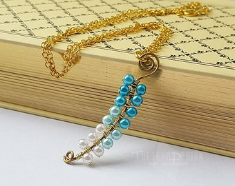 zelda twilight princess vessel of light necklace, the legend of zelda necklace, vessel of light, beaded spiral necklace, nintendo jewellery