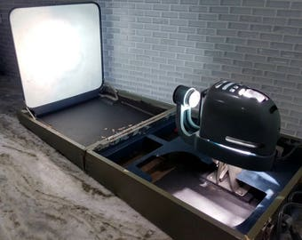 1950s Fuji Film Birdie Projector with case, built in projector screen in case. Comes with 2 film viewers. Projector works sold as is