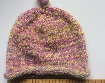 Child' hat - pink & yellow with topknot