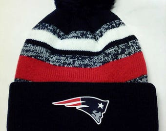 New England Patriots Heat Applied Logo, on a Knit Cuffed Beanie POM hat cap. Navy/Red/Wht. 3 Color! Unisex! Great quality Beanie!