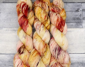 Courage - (Everyday Sock, variegated) - speckled crimson, gold, and brown