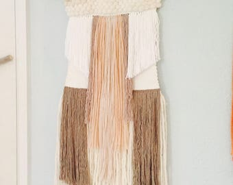 Woven wallhanging in soft neutrals