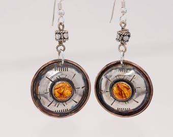 Earrings, sterling silver set off by an 8mm piece of gorgeous Amber.