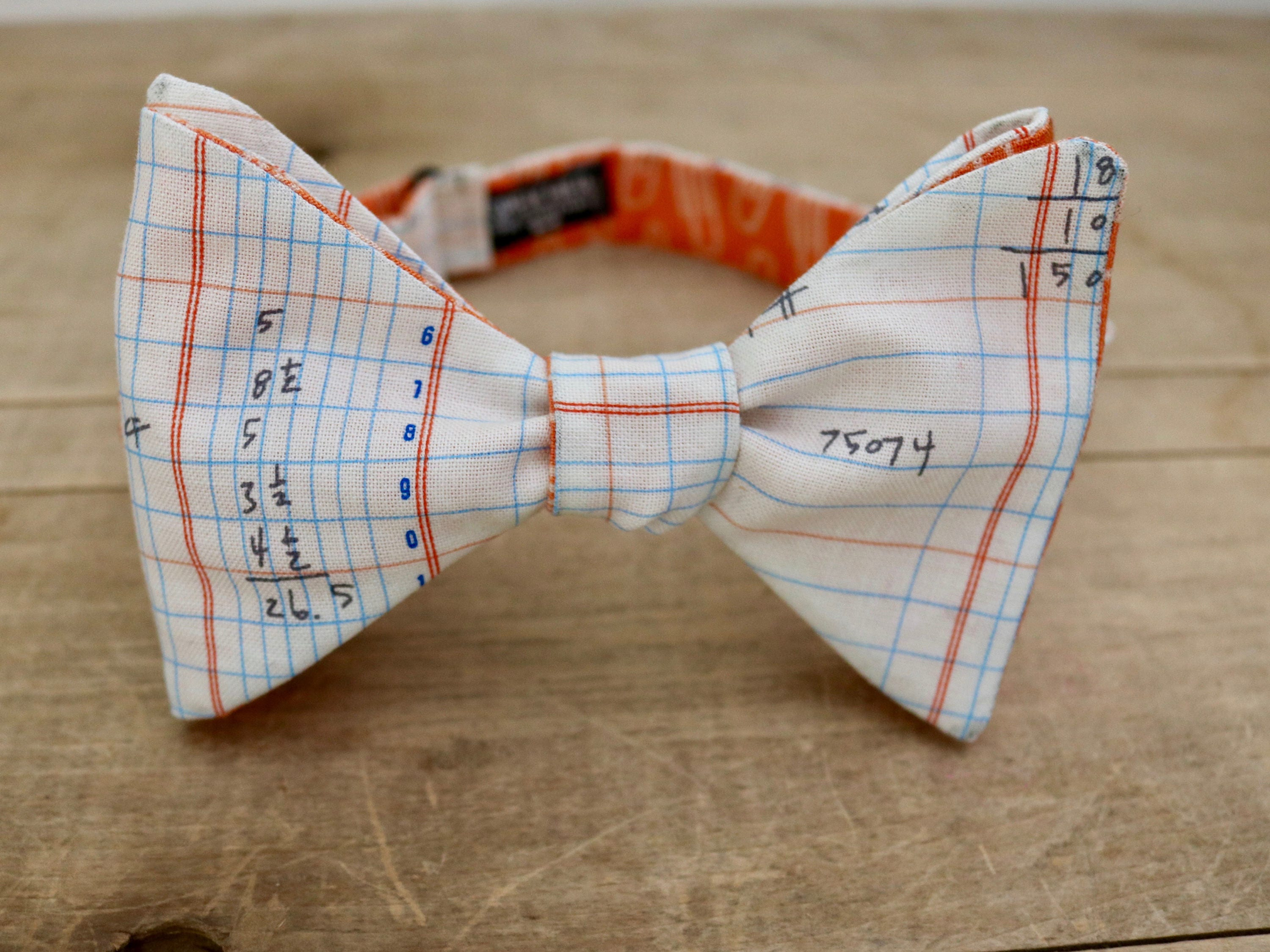 reversible math graph paper and orange paper clip bow tie by