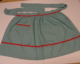 Vintage Cotton Print Apron / Green With White Flowers And Red Trim / Mid Century