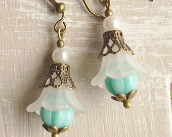 Earrings, turquoise and white lucite flower dangle earrings