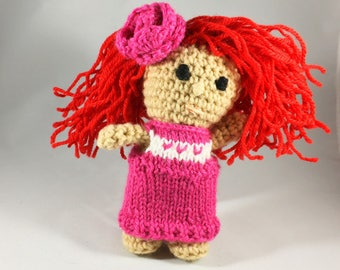 Red-haired cutie with pink dress and rose.