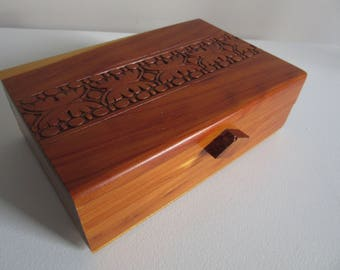 small hinged trinket box with carved top