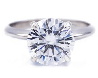Round Moissanite Platinum 4 Prongs Solitaire Ring