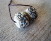 Lampwork Glass Pair of 2 etched Rustic Sandstone and Ivory Beads with fine silver
