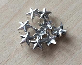 Claw silver tone star studs