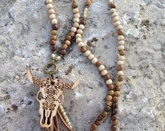 Necklace of wooden beads, Czech glass beads, Buffalo pendant