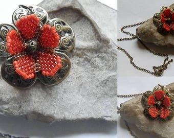 orange and bronze flower pendant