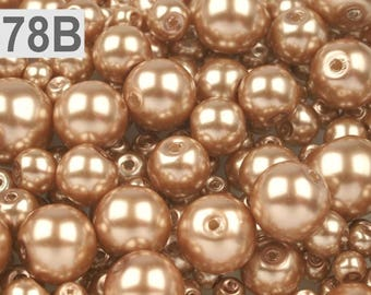 78 B - 100 g of 4-12 mm glass pearl beads different sizes
