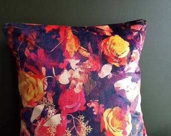 Sumptuous velvet floral cushion in stunning reds and oranges.